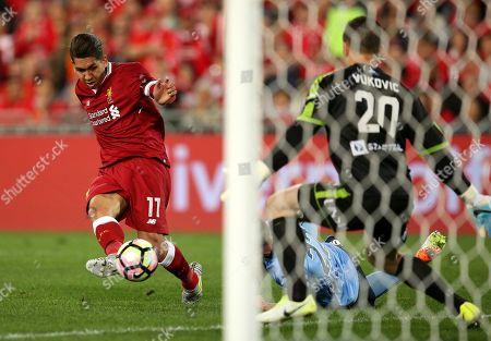 Roberto Firmino, Danny Vukovic Liverpool FC's Roberto Firmino, left, has a shot on Sydney FC's Danny Vukovic during their soccer friendly match in Sydney