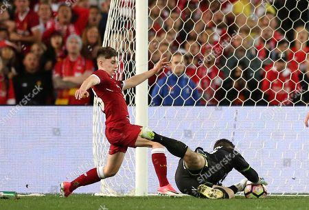 Ben Woodburn, Danny Vukovic Liverpool FC's Ben Woodburn, left, pressures Sydney FC's goalkeeper Danny Vukovic during their soccer friendly match in Sydney