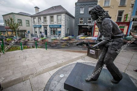 2017 An Post Ras Stage 4, Bundoran to Buncrana 24/5/2017. The riders of the 2017 An Post Ras pass by the statue of Rory Gallagher in Bundoran town