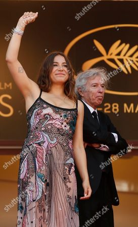 Jacques Doillon, Izia Higelin Actress Izia Higelin, left, and director Jacques Doillon wave to the crowds as they pose for photographers upon arrival at the screening of the film Rodin at the 70th international film festival, Cannes, southern France