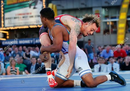 """Jordan Oliver, Frank Chamizo USA's Jordan Oliver battles Italy's Frank Chamizo during the East Meets West """"Beat the Streets"""" wrestling competition featuring former Olympians vs. Japanese competitors to benefit wrestling programs for New York City student-athletes in Times Square, in New York"""