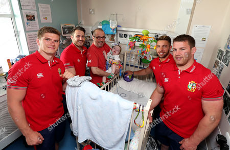 British & Irish Lions Visit University Children's Hospital Temple Street, Dublin 24/5/2017. Owen Farrell, Sean O'Brien, Tommy Seymour and Rhys Webb, members of the 2017 British & Irish Lions squad, visited University Children's Hospital Temple Street today, one of the Lions chosen charity partners for the Tour. . The squad are training in Dublin this week before departing for New Zealand on Monday. Pictured today: Owen Farrell, Tommy Seymour, Rhys Webb and Sean O'Brien with Henry Donnelly aged 2 years and Dad Robbie