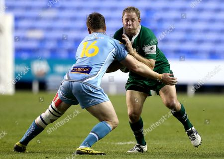 David Paice of London Irish is tackled by Ross Graham of Yorkshire Carnegie