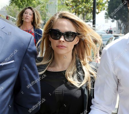Playboy model Dani Mathers leaves Los Angeles County Superior Court, after pleading no contest to charges she secretly snapped a photo of a naked 71-year-old woman in a locker room and posted it online with a mocking comment. She was sentenced to probation and 30 days community service