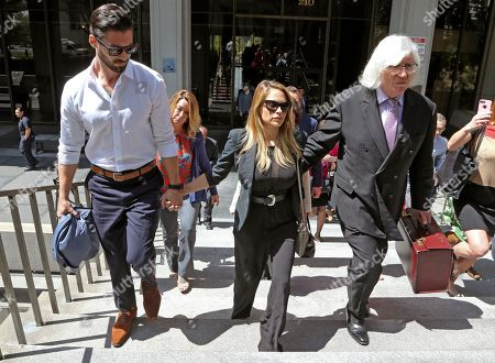 """Playboy model Danielle """"Dani"""" Mathers, center, leaves Los Angeles County Superior Court with her attorney Tom Mesereau, right, and her fiancé John Connor, after pleading no contest to charges that she took a photo of a naked, 71-year-old woman in a gym locker room and posted it on social media. She was sentenced to probation and 30 days community service"""