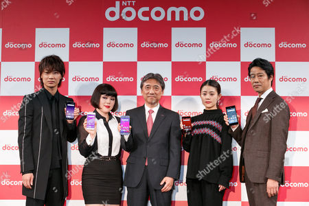 Actors Go Ayano, Buruzon Chiemi, NTT DoCoMo President Kazuhiro Yoshizawa, actress Mitsuki Takahata and actor Shinichi Tsutsumi, pose for cameras during the launch event for 8 new mobile devices for the summer lineup, Tokyo, Japan.