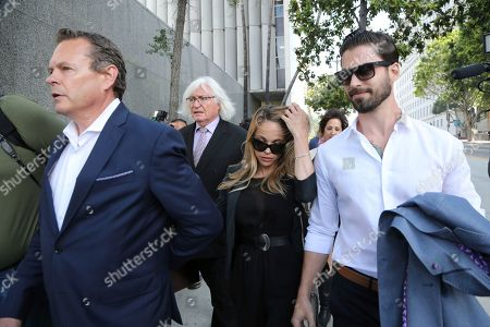 Dani Mathers, Dani Mathers, Tom Mesereau, John Connor Model and Playboy bunny Dani Mathers and her attorney Tom Mesereau, left rear, and her fiancé John Connor, right, leave Los Angeles County Superior Court, after pleading no contest to charges related to her taking a photo of a naked, 71-year-old woman in a gym locker room and posting it on social media with insults about the woman's body. She was sentenced to probation and 30 days community service
