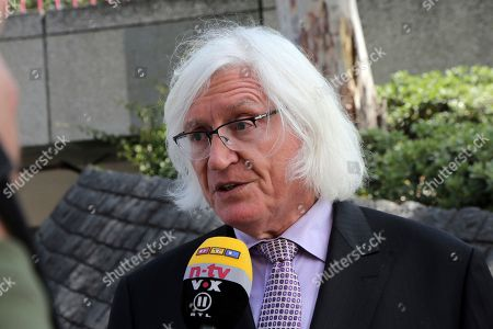 Stock Photo of Tom Mesereau, attorney for model and Playboy bunny Dani Mathers, talks to reporters outside Los Angeles County Superior Court, after Mathers pleaded no contest to charges related to her taking a photo of a naked, 71-year-old woman in a gym locker room and posting it on social media with insults about the woman's body. She was sentenced to probation and 30 days community service