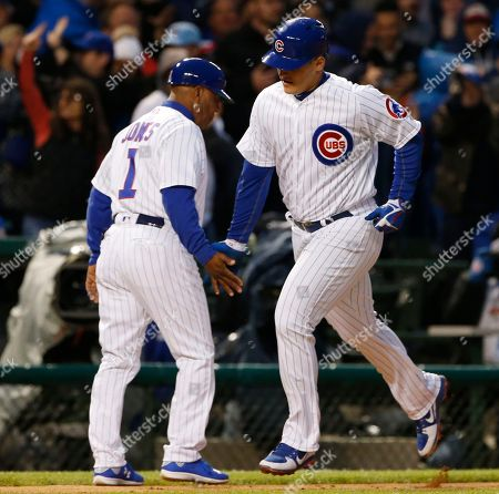 Anthony Rizzo, Gary Jones Chicago Cubs' Anthony Rizzo, right, celebrates with third base coach Gary Jones after hitting a solo home run in the second inning of a baseball game against the San Francisco Giants, in Chicago