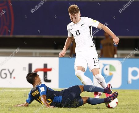Stock Photo of James Mcgarry of New Zealand vies for the ball with Jose Quiroz ( bottom ) of the Honduras during the group stage match of the FIFA U-20 World Cup 2017 between Honduras and New Zealand in Cheonan, South Korea, 25 May 2017.