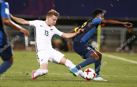 Stock Image of James Mcgarry ( L ) of New Zealand vies for the ball with Douglas Martinez  ( R ) of the Honduras during the group stage match of the FIFA U-20 World Cup 2017 between Honduras and New Zealand in Cheonan, South Korea, 25 May 2017.
