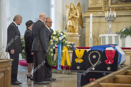 Stock Image of Representatives of the Central Bank of Finland, Olli Rehn (L), Seppo Honkapohja (2-L) , Marja Nykanen (2-R), and Erkki Liikanen (R) during the wreath ceremony of the State Funeral of former Finnish President Mauno Koivisto in Helsinki Cathedral in Helsinki, Finland, 25 May 2017. President Koivisto made a career in Central Bank of Finland before his Presidency.