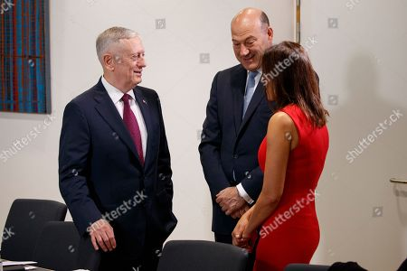 Jim Mattis, Gary Cohn, Dina Powell Secretary of Defense Jim Mattis, left, White House chief economic adviser Gary Cohn, center, and Deputy National Security adviser Dina Powell talk before a meeting between President Donald Trump and President of the European Commission Jean-Claude Junker and European Council President Donald Tusk, at European Union headquarters, in Brussels