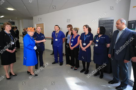 Escorted by Kathy Cowell (left) Chairman of the Central Manchester University Hospital, Queen Elizabeth II visits the Royal Manchester Children's Hospital to meet victims of the terror attack in the city earlier this week and to thank members of staff who treated them