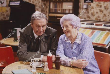Stock Image of Tom Mennard (as Sam Tindall) and Jill Summers (as Phyllis Pearce)