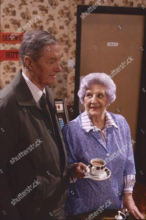 Tom Mennard (as Sam Tindall) and Jill Summers (as Phyllis Pearce)