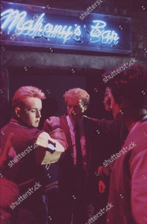 Brian Tilsley is stabbed to death outside a nightclub. Christopher Quinten (as Brian Tilsley) and Ian Aspinall (as Darren Whateley) far right.