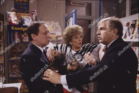 Brian Pettifer (as Bagshaw), Barbara Knox (as Rita Fairclough) and Peter Baldwin (as Derek Wilton)