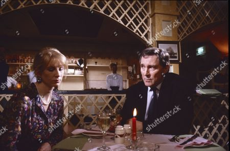 Louise Harrison (as Dawn Prescott) and Mark Eden (as Alan Bradley)