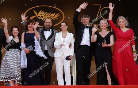 Valeriu Andriuta, Vasilina Makovtseva, Sergei Loznitsa Actor Valeriu Andriuta, third left, with actress Vasilina Makovtseva, centre, and director Sergei Loznitsa, third right, pose for photographers upon arrival at the screening of the film Krotkaya at the 70th international film festival, Cannes, southern France