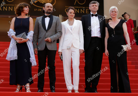 Valeriu Andriuta, Vasilina Makovtseva, Sergei Loznitsa Actor Valeriu Andriuta, second left, with actress Vasilina Makovtseva, centre, and director Sergei Loznitsa, second right, pose for photographers upon arrival at the screening of the film Krotkaya at the 70th international film festival, Cannes, southern France