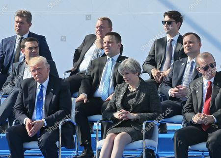 (bottom L-R) US President Donald Trump, British Prime Minister Theresa May, Turkish President Recep Tayyip Erdogan, (middle row L-R) Greek Prime Minister Alexis Tsipras, Estonian Prime Minister Juri Ratas, Polish President Andrzej Duda, (top row L-R) Iceland's Prime Minister Bjarni Benediktsson, Danish Prime Minister Lars Lokke Rasmussen, and Canadaian Prime Minister Justin Trudeau attend the unveiling ceremony of a monument at the NATO summit in Brussels, Belgium, 25 May 2017. NATO countries' heads of states and governments gather in Brussels for a one-day meeting.