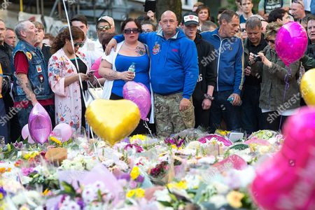 Stock Picture of Mother and father of of bombing victim Olivia Campbell , CHARLOTTE CAMPBELL and PAUL HODGSON attend a scooter-led rally to lay flowers at St Ann's Square in Central Manchester