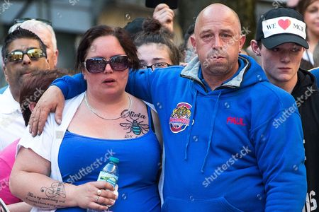 Mother and father of of bombing victim Olivia Campbell , CHARLOTTE CAMPBELL (with new Manchester Bee tattoo and tribute to Olivia) and PAUL HODGSON attend a scooter-led rally to lay flowers at St Ann's Square in Central Manchester