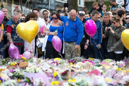 Mother and father of of bombing victim Olivia Campbell , CHARLOTTE CAMPBELL and PAUL HODGSON attend a scooter-led rally to lay flowers at St Ann's Square in Central Manchester