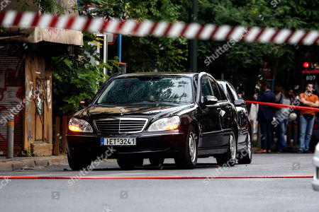 A car in which a device went off, on a central street, in Athens, . Greek police say former Prime Minister Lucas Papademos has been wounded in an explosion in a car in central Athens