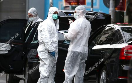 Greek police experts search for evidence at the scene of an explosion site in Athens, on . A bomb exploded inside the car of former Greek Prime Minister Lucas Papademos in central Athens on Thursday, wounding him and two Bank of Greece employees, officials said