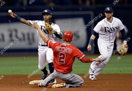 Stock Image of Andrelton Simmons, Michael Martinez, Daniel Robertson Tampa Bay Rays second baseman Michael Martinez, left, forces Los Angeles Angels' Andrelton Simmons at second base and relays the throw to first in time to turn a double play on Kole Calhoun during the sixth inning of a baseball game, in St. Petersburg, Fla. Backing up the play is Rays' Daniel Robertson