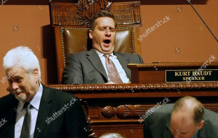 House Speaker Kurt Daudt yawns as he, chief clerk Patrick Duffy Murphy, left, and others wait for roll call to be completed during Day 3 of the special session in St. Paul, Minn. where lawmakers continue to make another run of passing the major remaining parts of a $46 billion budget