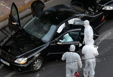 Police investigators inspect a Mercedes car of former Greek Prime Minister Lucas Papademos, after an explosion inside the car caused by a bomb attack in central Athens, Greece, 25 May 2017. Lucas Papademos, his driver and one other person was injured in the blast. According to the first reports, the explosion was caused by a booby-trapped envelope that went off while the car was in motion. The initial images indicate that the car suffered major damage. There was also a second car escorting the former premier.
