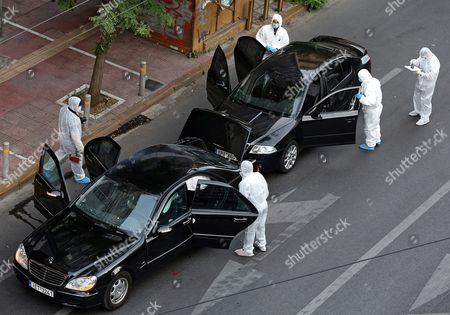 Police investigators inspect a Mercedes car of former Greek Prime Minister Lucas Papademos after an explosion inside the car caused by a bomb attack in central Athens, Greece, 25 May 2017. Lucas Papademos, his driver and one other person was injured in the blast. According to the first reports, the explosion was caused by a booby-trapped envelope that went off while the car was in motion. The initial images indicate that the car suffered major damage. There was also a second car escorting the former premier.