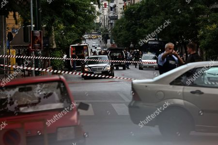 Policemen gordon the area around a Mercedes car of former Greek Prime Minister Lucas Papademos after an explosion inside the car caused by a bomb attack in central Athens, Greece, 25 May 2017. Lucas Papademos, his driver and one other person was injured in the blast. According to the first reports, the explosion was caused by a booby-trapped envelope that went off while the car was in motion. The initial images indicate that the car suffered major damage. There was also a second car escorting the former premier.