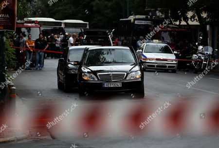 Policemen cordoned off the area around a Mercedes car of former Greek Prime Minister Lucas Papademos after an explosion inside the car caused by a bomb attack in central Athens, Greece, 25 May 2017. Lucas Papademos, his driver and one other person was injured in the blast. According to the first reports, the explosion was caused by a booby-trapped envelope that went off while the car was in motion. The initial images indicate that the car suffered major damage. There was also a second car escorting the former premier.