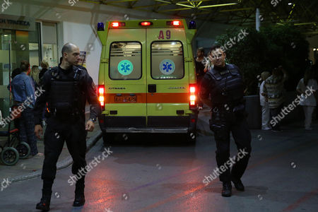 Police officers stand on duty outside the hospital where former Greek Prime Minister Lucas Papademos is hospitalised, injured, after an explosion inside his car, caused by a bomb attack, in central Athens, Greece, 25 May 2017. Lucas Papademos, his driver and one other person was injured in the blast. According to the first reports, the explosion was caused by a booby-trapped envelope that went off while the car was in motion.