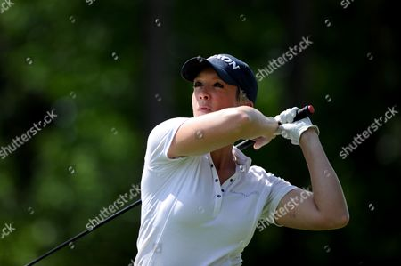 Stock Image of Georgie Bingham drives from the 15th in the Pro-Am event prior to the European Tour BMW PGA Championship on re-modelled West Course at the Wentworth Club, Surrey.