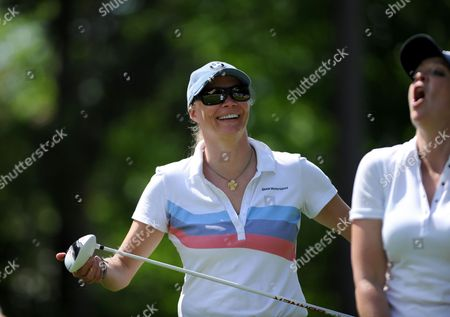 Model and presenter Jodie Kidd shares a joke with Georgie Bingham in the Pro-Am event prior to the European Tour BMW PGA Championship on re-modelled West Course at the Wentworth Club, Surrey.