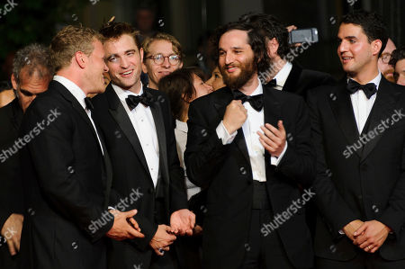 Robert Pattinson, Buddy Duress, Taliah Webster, Benny Safdie, Josh Safdie Producer Sebastian Bear, left, actor Robert Pattinson, and directors Josh Safdie and Benny Safdie, pose for photographers upon arrival at the screening of the film Good Time at the 70th international film festival, Cannes, southern France