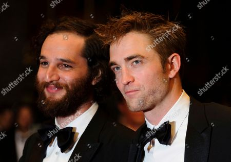 Robert Pattinson, Josh Safdie Director Josh Safdie, left, actor Robert Pattinson, and director Benny Safdie, pose for photographers upon arrival at the screening of the film Good Time at the 70th international film festival, Cannes, southern France