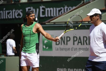 Rafael Nadal and his uncle Toni Nadal during a training session.