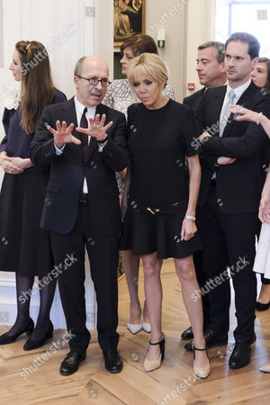 Jean-Marc Loubier and Brigitte Trogneux during a visit to the shop Delvaux put together for the spouses of NATO leaders.