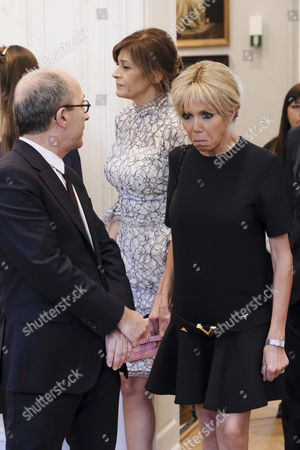 Stock Photo of Jean-Marc Loubier, Desislava Radeva and Brigitte Trogneux during a visit to the shop Delvaux put together for the spouses of NATO leaders.