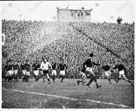 Rugby Union International Matches 1950/51 Scotland V Ireland At Murrayfield Final Score Scotland 5 Ireland 6 Ian Thomson Kicks For Touch With An Irish Player Rushing In W.i.douglas Elliot Is Covering Up On Thomson's Right.