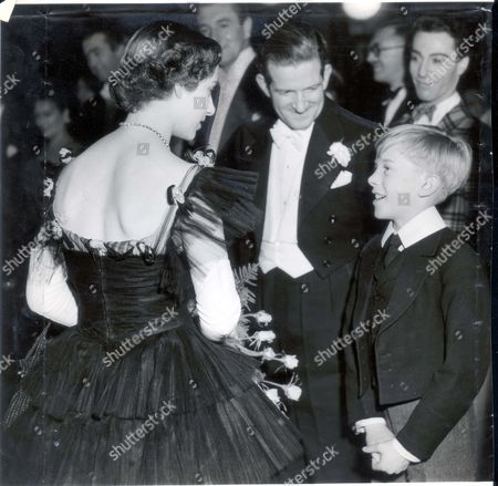 Princess Margaret 1950 30/10/50 Royal Command Film Performance. 'the Mudlark' Himself - Standing Next To His Comedian Father Ted Ray - Chats To Princess Margaret. His Name: Andrew; Age 11. Resplendent In An Eton Jacket He Told The Princess: 'i Enjoyed Making The Film Very Much.' Their Majesties The King And Queen And The Two Princess's Dressed In Black In Memorium For King Gustave Of Sweden Tonight Attended The Royal Command Film Performance At The Leicester Square Empire. The Film Was The Mudlark Starring Irene Dunne And Dealing With The Reign Of The Queen Victoria.