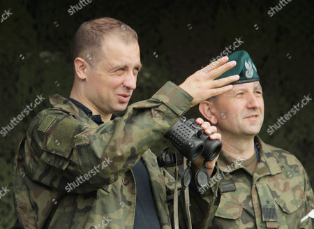 Deputy Minister of Defence Tomasz Szatkowski (L) and the commander of the 15th Mechanised Brigade in Gizycko Jaroslaw Gromadzinski (R) during the Puma-17 military exercise in Orzysz, north east Poland, 26 May 2017. In the exercises take part Polish 15th Mechanised Brigade from Gizycko and NATO battalion battle group. The exercises are aimed to check the cooperation of military systems and the coordination of each units of the group, before Saber Strike 17 maneuvers, which are scheduled for June 2017.