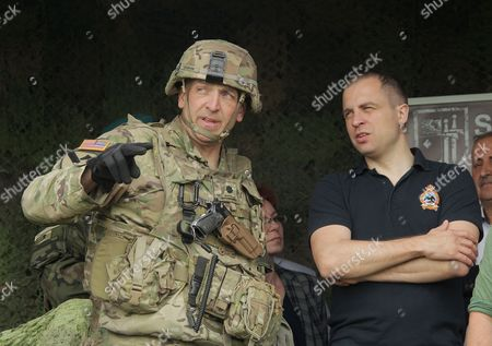 Deputy Minister of Defence Tomasz Szatkowski (R) and Commander of NATO's multi-national battalion, US Lieutenant Colonel Steven Gventer (L) during the Puma-17 military exercise in Orzysz, north east Poland, 26 May 2017. In the exercises take part Polish 15th Mechanised Brigade from Gizycko and NATO battalion battle group. The exercises are aimed to check the cooperation of military systems and the coordination of each units of the group, before Saber Strike 17 maneuvers, which are scheduled for June 2017.