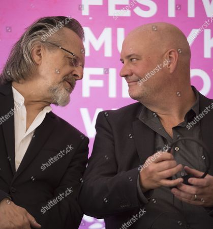 Trevor Morris (L), a Canadian orchestral composer and Jan A. P. Kaczmarek (R), an Oscar-Winning Polish composer attend a press conference on the first day of the 10th edition of Krakow Film Music Festival in Krakow, Poland